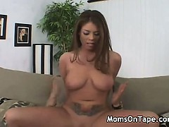 Tatooed mom gets a fuck in the livingroom