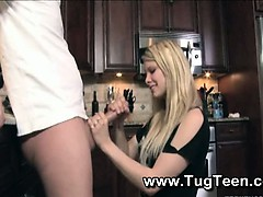 blonde-teen-gives-handjob