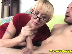 handjob-blonde-mature-with-glasses-jerks-young-dude