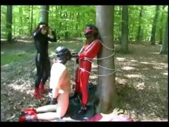 hot-domina-punishes-her-slaves-outdoors