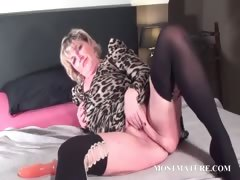 blondie-fucks-her-mature-twat-with-dildo