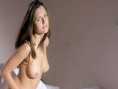 Busty Coed Wow Stripping On A Bed